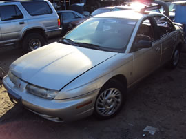 1999 SATURN 4 DOOR SEDAN SL2 MODEL 1.9L DOHC AT FWD COLOR GOLD 149872